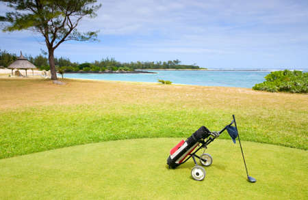 Coastal Golf Course. Golf clubs in bag and ball on a beautiful golf course  photo