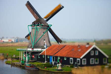 Picturesque windmill in Zaanse Schans, The Netherlands photo