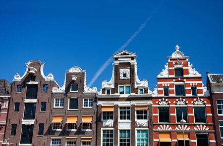 stoneworks: Typical Amsterdam houses over blue sky