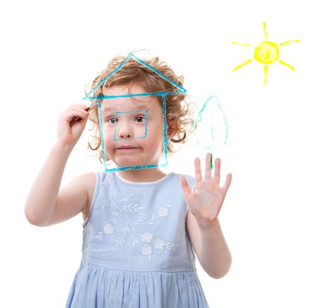 Little girl drawing on glass. Isolated on white. photo