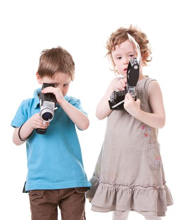 Young Photographers. Two small kids playing with antique cameras.  photo