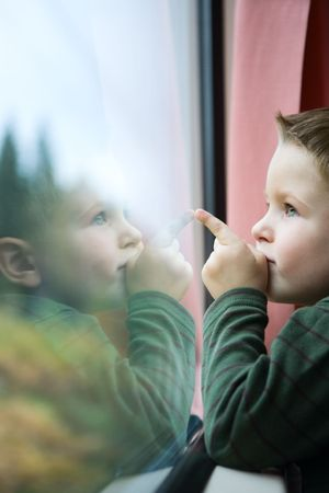 Cute 4-years old boy traveling by train Stock Photo