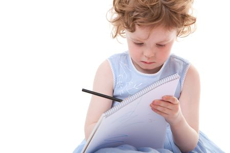 Little girl drawing with pencils. Isolated on white. photo