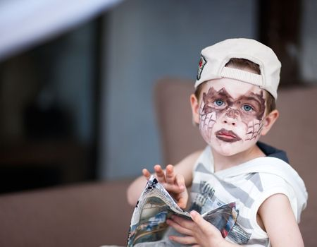 Small boy having his face painted photo