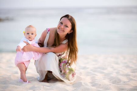 Young mother and baby girl on white sand tropical beach Stock Photo - 5293795
