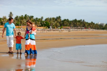 Young happy family with two kids on beach vacation Stock Photo - 5334162