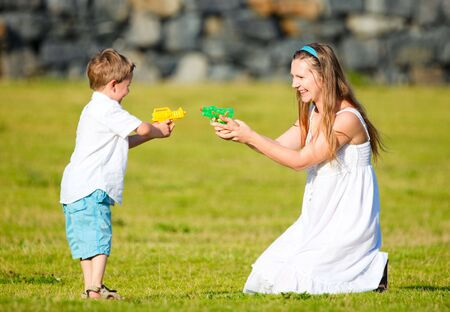 Mother and son having fun outdoors at sunny summer day photo