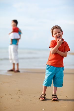 Young father with two kids at the beach Stock Photo - 5371282