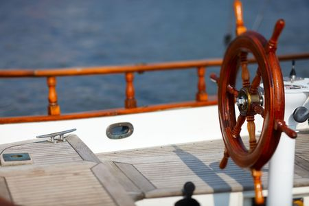 Wooden wheel on luxury yacht photo