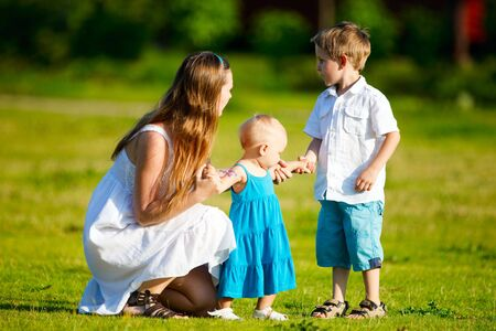 Mother and two kids having fun outdoors at sunny summer day Stock Photo - 5410759