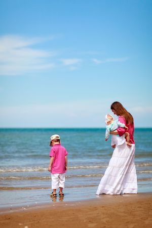 Young mother with two kids at the beach Stock Photo - 5440642