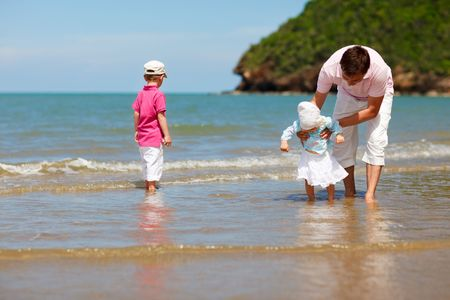 Young father with two kids at the beach Stock Photo - 5440626
