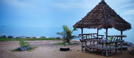 Rainy season. Beautiful exotic bamboo hut on the beach at rainy day. Stock Photo - 5498057