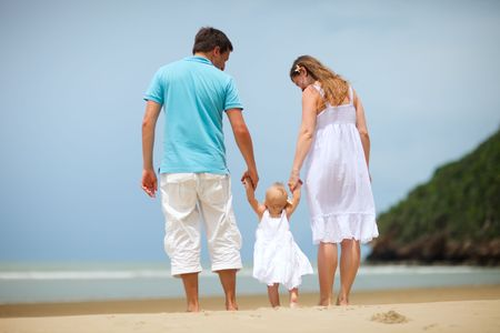 Young family of three on tropical beach. Stock Photo - 5518209
