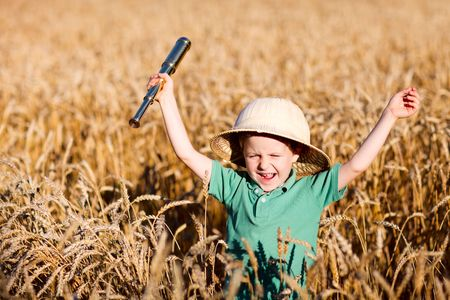 Portrait of young nature explorer in wheat field photo