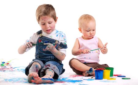 Cute 5 years old boy and toddler girl painting on white background Stock Photo - 5774474