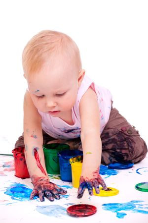 hand painting: Cute 1 year old toddler girl painting on white background
