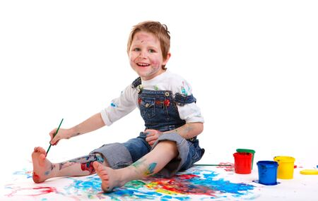 Cute 5 years old boy painting on white background Stock Photo - 5774477