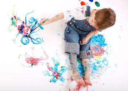 Cute 5 years old boy painting on white background Stock Photo - 5774489
