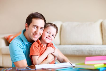 Young father and his son drawing and reading together Stock Photo - 5774487