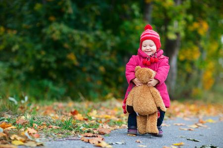 Cute 1 year old girl walking outdoors at autumn day Stock Photo - 5774485
