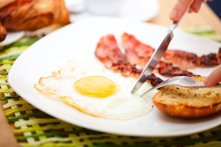 Delicious breakfast. Fried egg, bacon, toast, croissants, juice and fresh coffee. photo