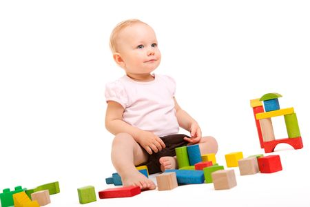 Cute baby girl building with colorful wooden blocks. Isolated on white background Stock Photo - 5906160