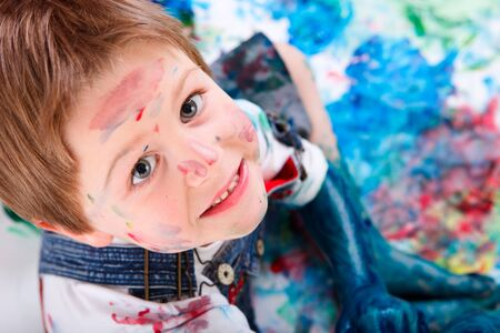 Portrait of cute 5 years old boy painting on white background Stock Photo - 5938483