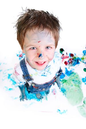 Funny photo of cute 5 years old boy painting on white background Stock Photo - 5938486