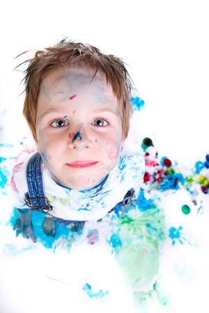Funny photo of cute 5 years old boy painting on white background Stock Photo - 6181152