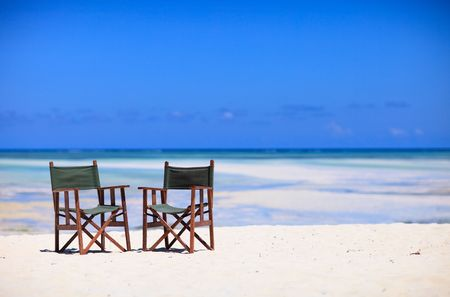 inviting: Inviting photo of two chairs on white sand tropical beach on Zanzibar island