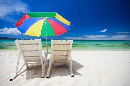 Two beach chairs on perfect tropical white sand beach in Boracay, Philippines photo