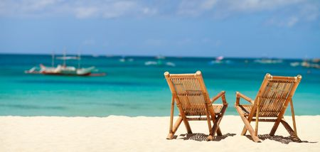 chairs: Two beach chairs on perfect tropical white sand beach in Boracay, Philippines