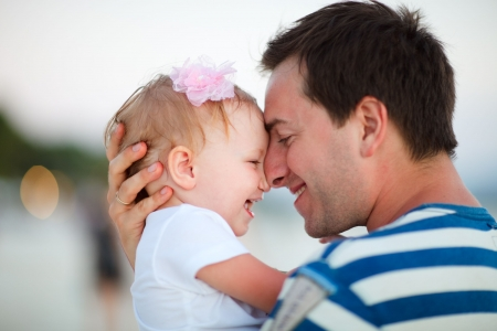 father with children: Portrait of happy father and his adorable little daughter Stock Photo
