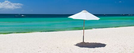 boracay: White umbrella on perfect tropical beach in Boracay, Philippines Stock Photo