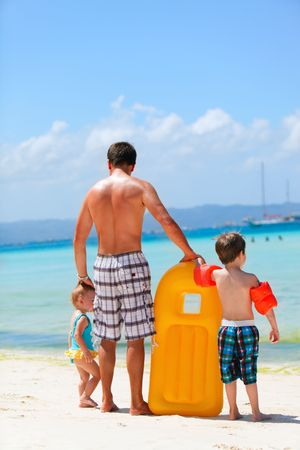 Happy father with his two kids enjoying beach vacation Stock Photo - 6778365