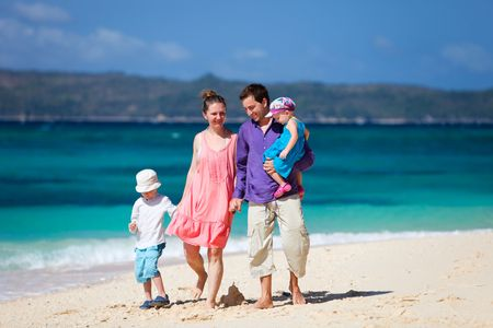 Family with two kids on white sand tropical beach Stock Photo - 6778367