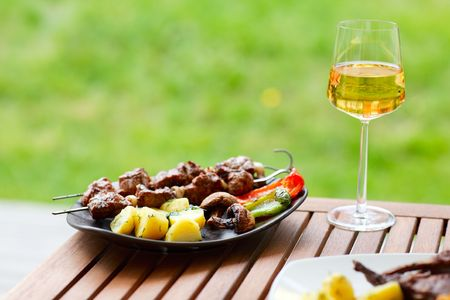 served:  Fresh grilled meat and vegetables served outdoors Stock Photo