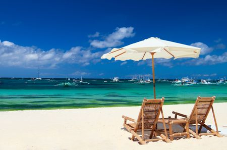Beach chairs on perfect tropical white sand beach in Boracay, Philippines Stock Photo