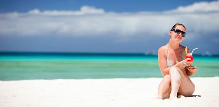 beach drink: Portrait of young beautiful woman with tropical fresh juice Stock Photo