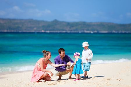 Family of four having fun on tropical beach Stock Photo - 6833790
