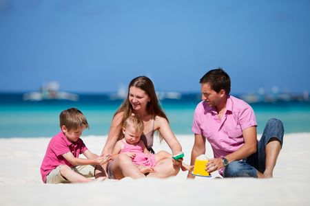 Family of four having fun on tropical beach Stock Photo - 6833791