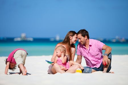 Family of four having fun on tropical beach Stock Photo - 6833786