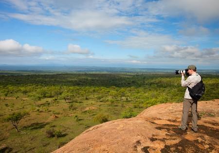Nature photographer taking photos on safari in Tanzania Stock Photo - 6964285