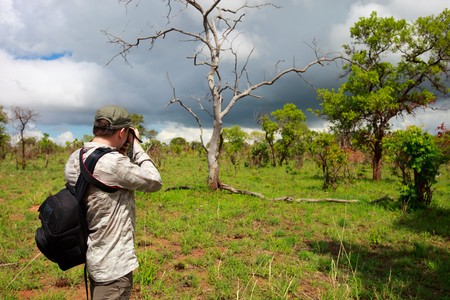 Nature photographer taking photos on safari in Tanzania Stock Photo - 6964284