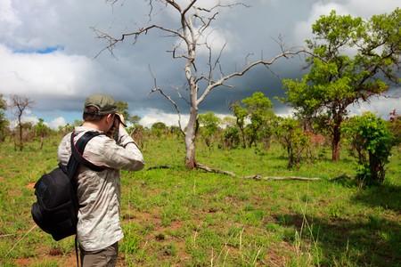 Nature photographer taking photos on safari in Tanzania Stock Photo - 6964284