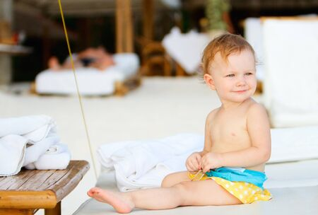 Adorable toddler girl on beach vacation photo