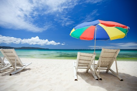 Beach chairs on perfect tropical white sand beach Stock Photo