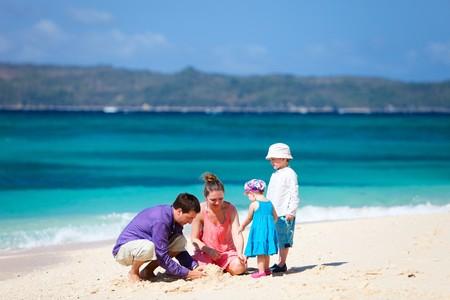 Family of four having fun on tropical beach Stock Photo - 6982092