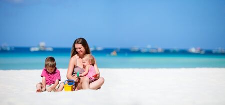 Young mother with her two kids on tropical beach vacation Stock Photo - 6982093